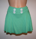 Green skirt with shorts.